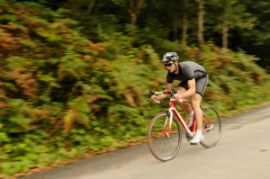 Road cyclist at downhill with blurred background