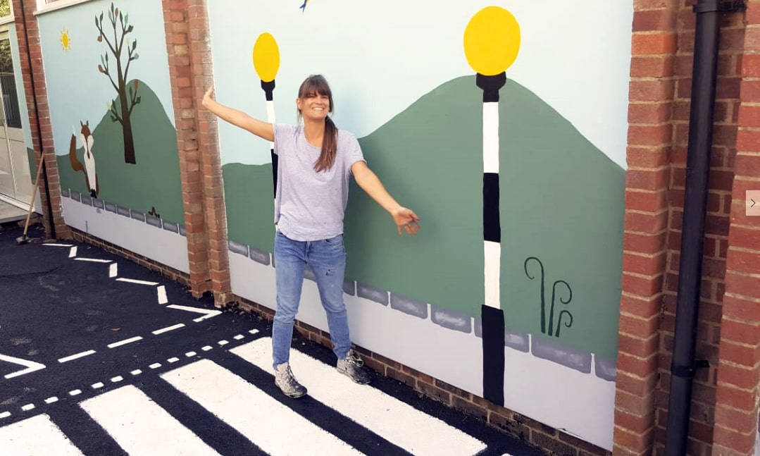 corinne finishes painting pinkneys green outdoor area with Protect Your Bubble